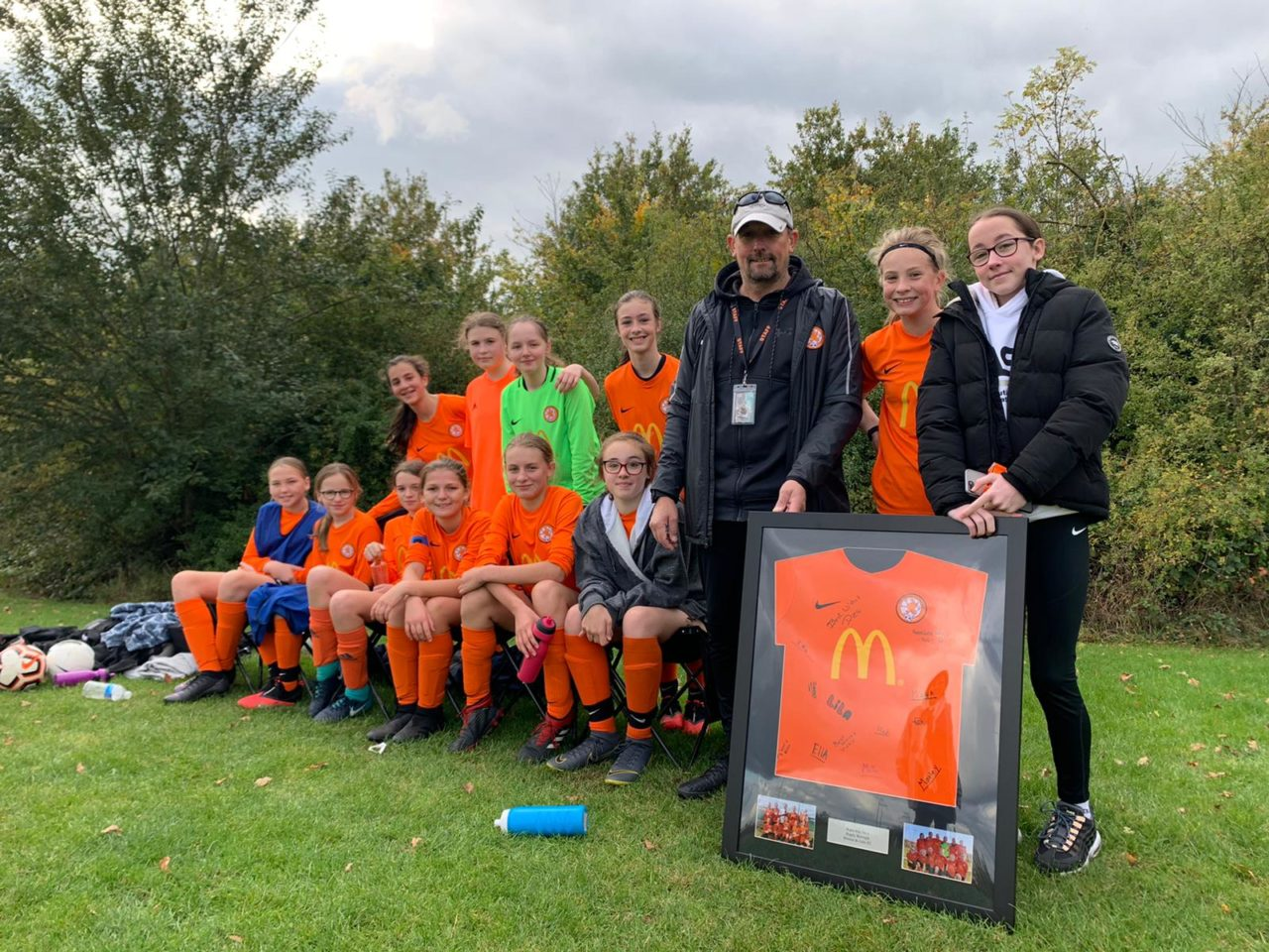 U13s Present Shirt to Katie | Rugby Borough FC